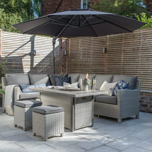 0193343-5510C Palma corner set white wash with 0193321-5510 fire pit table and PL33-184-BT 3.3m free arm parasol lifestyle